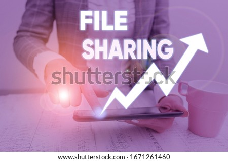 Conceptual hand writing showing File Sharing. Business photo text transmit files from one computer to another over a network. #1671261460