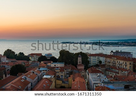 View over the rooftops of Zadar from the bell tower at the sunset, Adriatic Sea, Croatia