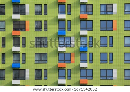 """New building facade in housing complex """"Buninskiye luga. PIK"""", Butovo, Moscow city, Russia. Modern style in architecture. House in Moscow dormitory area. Symmetry in exterior. Urban. Moscow landmark"""