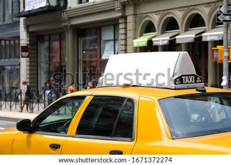 Taxi top advertising. Billboard display on yellow cab.