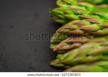asparagus fresh green on black background #1671381853