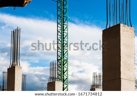 Construction of a new residential building, with the concrete columns shuttering in sight. #1671734812