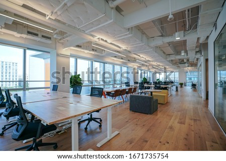 Interior of modern empty office building.Open ceiling design. #1671735754