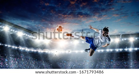 Soccer player on stadium in action. Mixed media Royalty-Free Stock Photo #1671793486