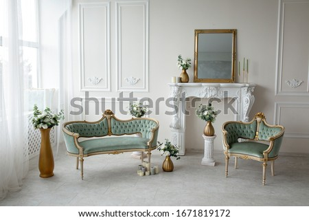 Vintage green armchairs in the interior near the fireplace Royalty-Free Stock Photo #1671819172