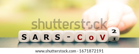 """Hand turns dice and changes the expression """"Sars-CoV1"""" to """"Sars-CoV2"""". #1671872191"""