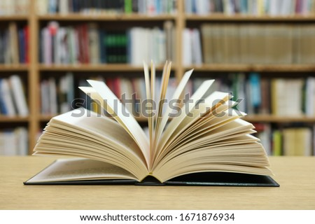 Open book in the library #1671876934