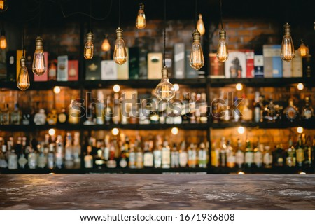 Metal table and vintage lamps  with liquor bar background Royalty-Free Stock Photo #1671936808