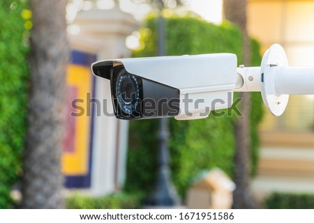 Cctv camera system , Outdoor IP Surveillance Camera hight technology store up to 24 hours of camera activity to playback later.Concept of home security technology  #1671951586