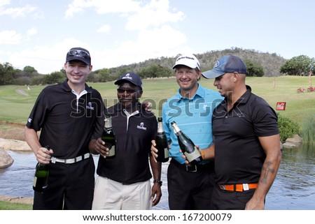 TOURNAMENT WINNERS  - NOVEMBER 17: Gary Player Charity Invitational Golf Tournament  November  17, 2013, Sun City, South Africa. Anthony Leeming, Mike Dladla, Herschelle Gibbs and  Retief Goosen. #167200079
