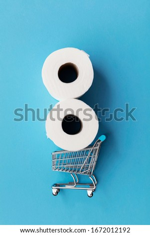 Roll of white toilet paper with a shopping cart on a blue background #1672012192