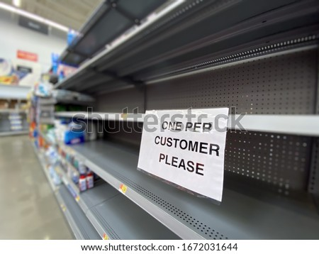 A view of empty shelves at a department store during the Coronavirus pandemic of 2020. #1672031644