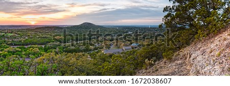 Sunset Panorama of Wimberley and Blanco River Valley from the top of Mt Baldy - Texas Hill Country Royalty-Free Stock Photo #1672038607