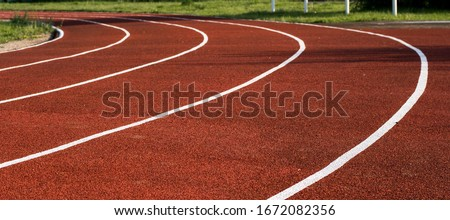 Running track in the stadium. Rubber coating.  Royalty-Free Stock Photo #1672082356