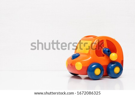 Children car toy on white background with copy space. #1672086325