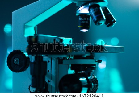 Close-up of scientific microscope. Laboratory in hospital. Epidemic disease, healthcare, vaccine research and coronavirus 2019-ncov test. #1672120411