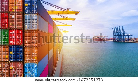 Container ship carrying container box in import export with quay crane, Global business cargo freight shipping commercial trade logistic and transportation oversea worldwide by container vessel #1672351273