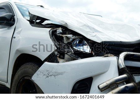 Car Crash, White Car Get Damaged by Accident on the Road. #1672401649