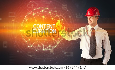 Handsome businessman with helmet drawing CONTENT CURATION inscription, social construction concept