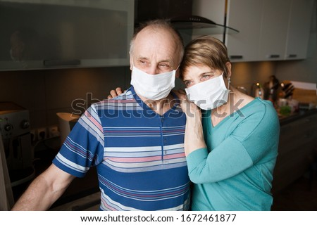 Seniors couple  wearing medical face mask and recovery from the illness in home. quarantine. health concept. Corona Virus.  #1672461877