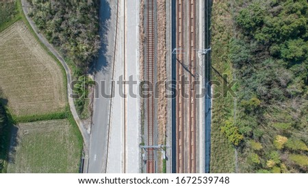 Shoot the tracks with a drone. Take a picture of the railway track from directly above