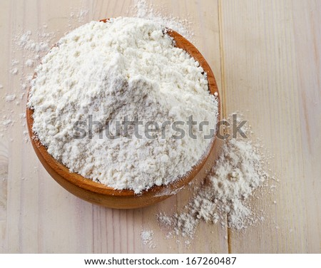 flour on a wooden table. selective focus #167260487