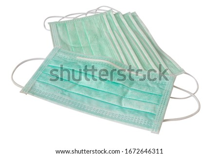 Green surgical masks with rubber ear straps for cover mouth and nose to protect virus or bacteria isolated on white background, clipping path included #1672646311