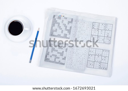 crossword and pen on white background #1672693021