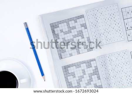 crossword and pen on white background #1672693024