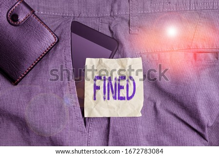 Handwriting text writing Fined. Concept meaning clarify beer by causing precipitation of sediment during production Smartphone device inside trousers front pocket with wallet and note paper. #1672783084