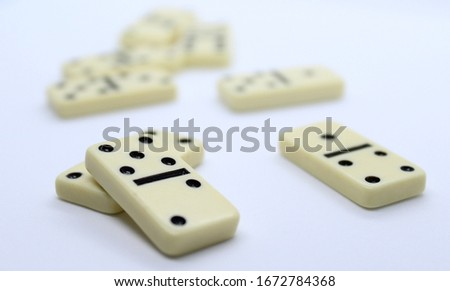 White dominoes on white background. #1672784368