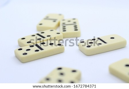 White dominoes on white background. #1672784371