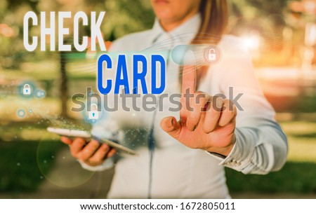 Word writing text Check Card. Business concept for allows an account holder to access funds in her account. #1672805011