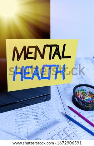 Text sign showing Mental Health. Conceptual photo demonstratings condition regard to their psychological well being Note paper taped to black computer screen near keyboard and stationary.