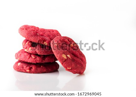 A homemade red velvet cookies with white chocolate chips on white background.