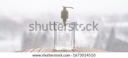 Hand sanitizer bottle on banner header background for COVID-19 Coronavirus concept. #1673014510