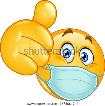 Emoji emoticon with medical mask over mouth showing thumb up Royalty-Free Stock Photo #1673061742