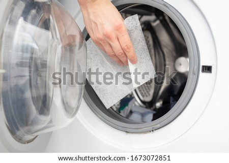soft your laundry by droping dryer sheets into your dryer or washing mashine by hand, so it will smell fresh Royalty-Free Stock Photo #1673072851