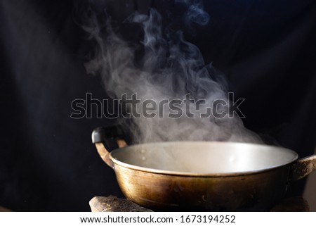 White smoke from cooking pot on stove in countryside kitchen. soft picture