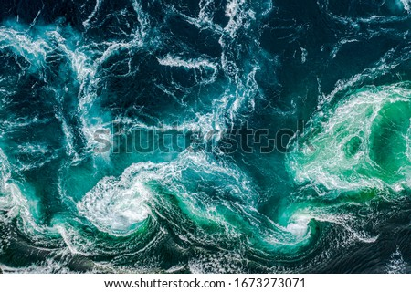 Abstract background. Waves of water of the river and the sea meet each other during high tide and low tide. Whirlpools of the maelstrom of Saltstraumen, Nordland, Norway #1673273071