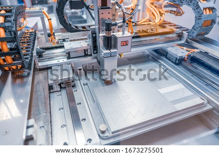 Metalworking CNC lathe milling machine. Cutting metal modern processing technology. Milling is the process of machining using rotary cutters to remove material by advancing a cutter into a workpiece. #1673275501