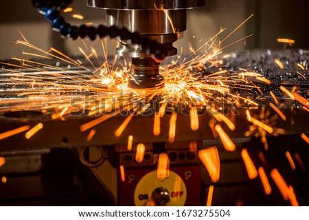 Metalworking CNC lathe milling machine. Cutting metal modern processing technology. Milling is the process of machining using rotary cutters to remove material by advancing a cutter into a workpiece. #1673275504