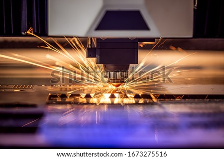 CNC Laser cutting of metal modern industrial technology. Laser cutting works by directing the output of a high-power laser through optics. Laser optics and CNC computer numerical control. #1673275516