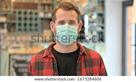 Portrait of Beard Young Man with Protective Face Mask #1673284606