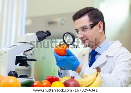 Laboratory worker examining fruits and vegetables and making analysis for pesticides and nitrates. #1673294341