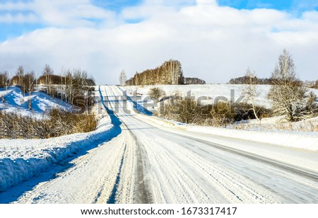 Winter snow rural road landscape. Winter snow road. Rural winter snow road. Winter road landscape #1673317417