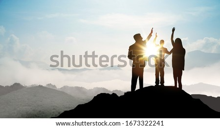 Silhouette of Business team show arm up on top of the mountain. Leadership and success Concept. Royalty-Free Stock Photo #1673322241