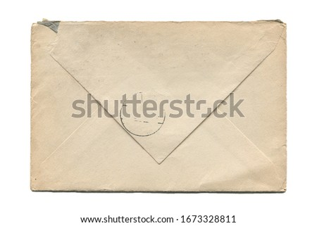 front view closeup of blank old aged closed letter paper envelope with torn edges and faded stamp print isolated on white background Royalty-Free Stock Photo #1673328811