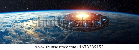 UFO, an alien plate hovered motionless in space against the background of the earth. alien invasion, spacecraft of the humanoids. Some elements of the image provided by NASA mixed medium Royalty-Free Stock Photo #1673335153