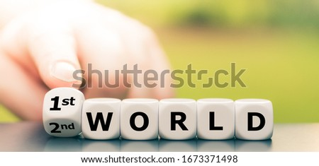 """Hand turns dice and changes the expression """"2nd world"""" to """"1st world"""". #1673371498"""